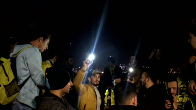 fenerbahce fans sing songs and wave flares as they ride the ferry back to istanbul's european side after watching the istanbul derby match between... - ferry ride stock videos & royalty-free footage