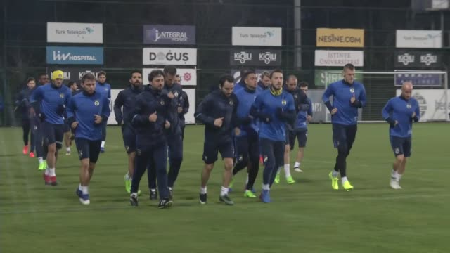 Fenerbahce players attend a training session led by head coach Dick Advocaat the day before the UEFA Europa League Round of 32 second leg soccer...