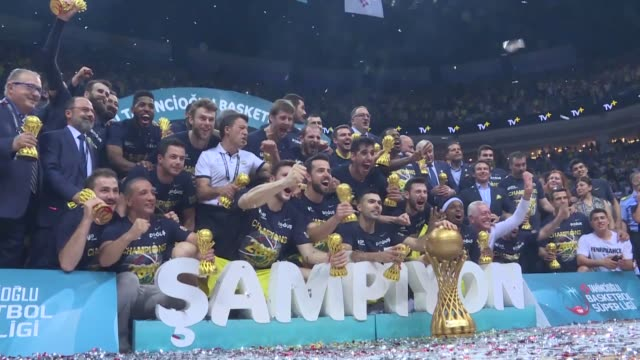 fenerbahce players celebrate with the trophy after wining the tahincioglu basketball super lig playoff finals game against against tofas at ulker... - basketball player stock videos & royalty-free footage