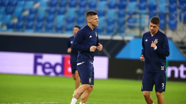 Fenerbahce players take part in a training session at the Gazprom Arena in Saint Petersburg Russia on February 20 2019 Turkey's Fenerbahce will face...