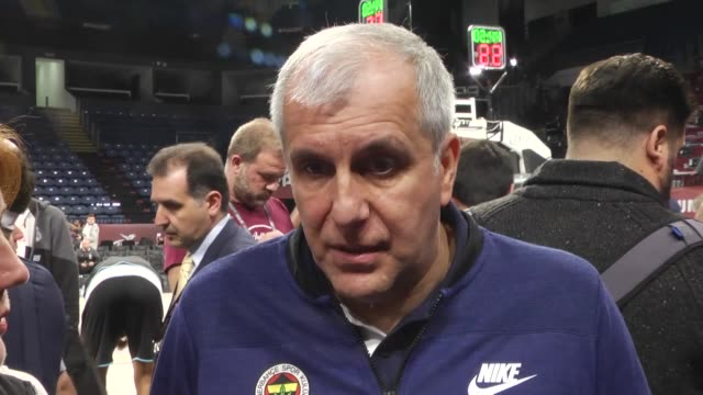 Fenerbahce's head coach Zeljko Obradovic and guard Melih Mahmutoglu speak to the media during team practice the day before the Turkish Airlines...