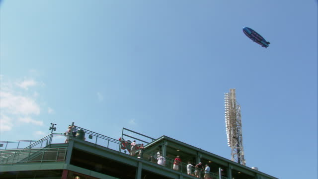 MS LA TS Fenway Park exterior, TV Blimp flying over park during game / Boston, Massachusetts, USA