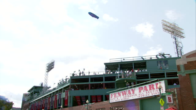 ms la fenway park exterior, tv blimp flying over park during game / boston, massachusetts, usa - baseballmannschaft stock-videos und b-roll-filmmaterial