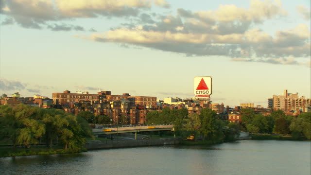 ws fenway-kenmore neighborhood with citgo sign across charles river / boston, massachusetts, usa - river charles stock videos & royalty-free footage