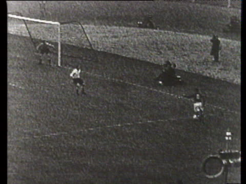 ferenc puskas with brilliant drag back to send billy wright sliding wrong way before he smashes ball home for 13 lead england vs hungary... - international match stock videos & royalty-free footage