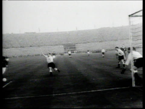 Ferenc Puskas with brilliant drag back to send England captain Billy Wright sliding wrong way before he smashes ball home for 13 lead England vs...