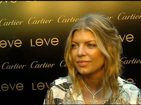 fergie on the peapod foundation, on why it's important that cartier is giving back, on picking orange for the color of her bracelet and on her... - cartier stock videos & royalty-free footage