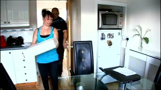 lib fergus carrying box towards in kitchen - jon venables stock-videos und b-roll-filmmaterial