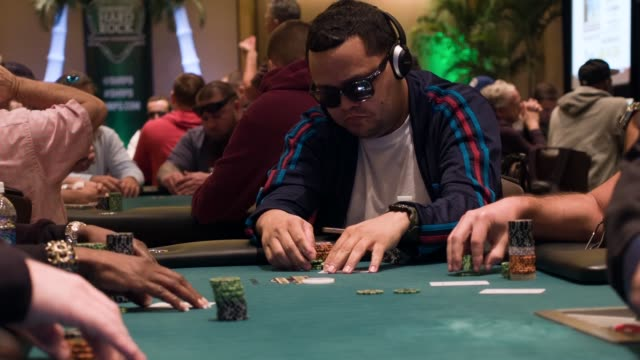 fernando vasquez sits at a poker table during the opening day of the seminole hard rock poker showdown on march 27, 2014 in hollywood, florida. the... - hollywood florida stock videos & royalty-free footage