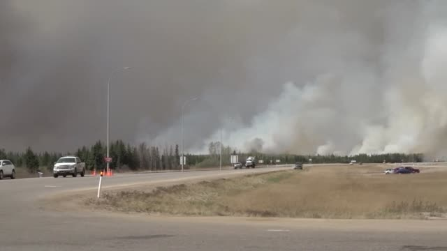 A ferocious wildfire wreaking havoc in Canada doubled in size Saturday and officials warned that the situation in the parched Alberta oil sands...