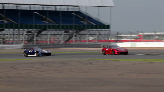 ferrari 599xx no27 & 45 at silverstone racetrack, england. - silverstone stock videos & royalty-free footage