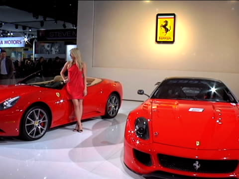 vídeos y material grabado en eventos de stock de ws ferrari california and ferrari 599xx beautiful blonde in slinky red dress walks over to california and poses for pictures next to it / ws la front... - ferrari