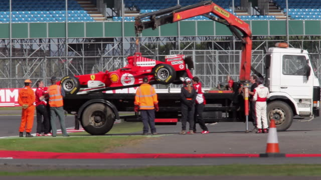 ferrari grand prix car is recovered in silverstone race track, england. - silverstone stock videos & royalty-free footage