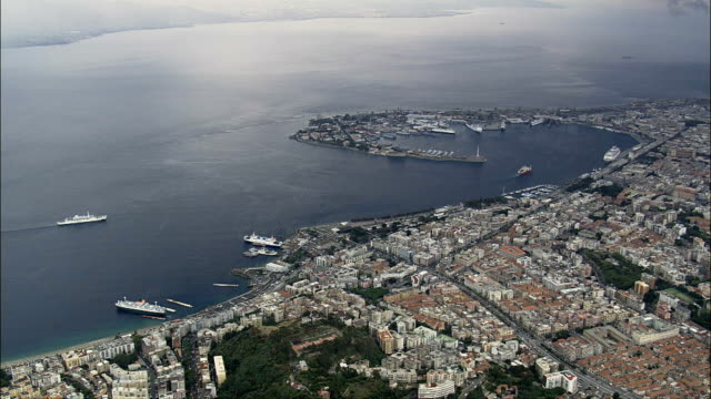 Ferries And Ships In the Straits Of Messina  - Aerial View - Sicily, Province of Messina, Messina, Italy