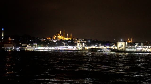Ferries are seen at night around the Eminonu ferry terminal on February 16 2016 in Istanbul Turkey