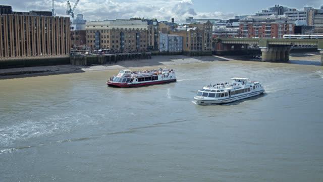 ferries in thames river. london bridge. residential neighborhood. - ferry stock videos & royalty-free footage