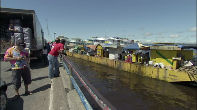 ferries moor at a busy dock in manaus, brazil. - manaus stock videos and b-roll footage
