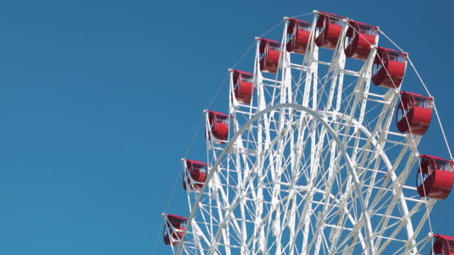 ferris wheel and blue sky. - ferris wheel stock videos & royalty-free footage