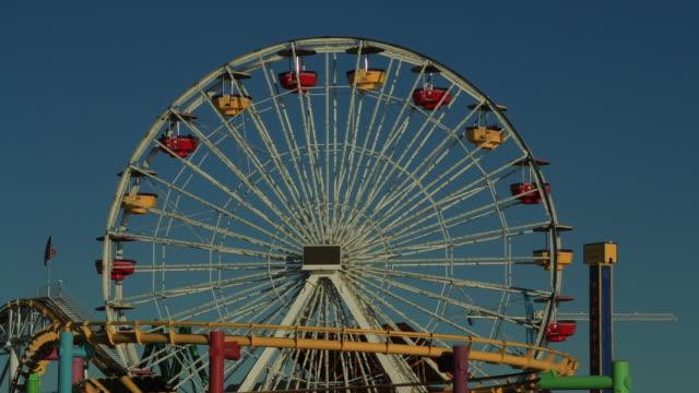 ws ferris wheel and roller coaster / santa monica, california, united states - big wheel stock videos & royalty-free footage