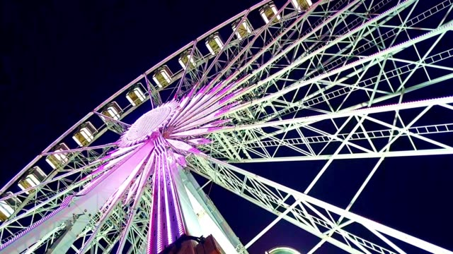 ferris wheel at amusement park at night - high up stock videos & royalty-free footage