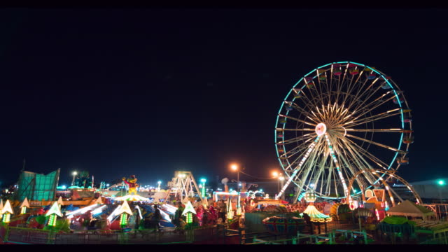 ferris wheel at night time lapse - school fete stock videos and b-roll footage