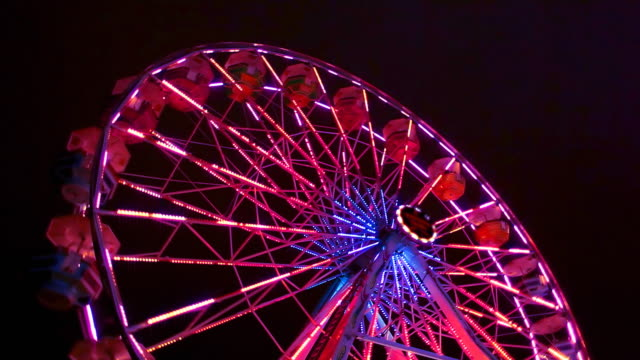 ferris wheel carnival ride at night - ferris wheel stock videos & royalty-free footage