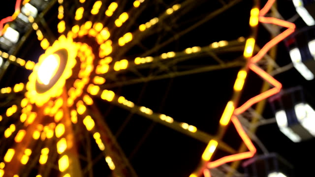 ferris wheel defocused night hd video - big wheel stock videos & royalty-free footage