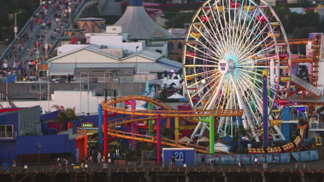 aerial ferris wheel in the pacific park amusement park on the santa monica pier - santa monica pier stock videos & royalty-free footage