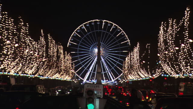 ws zo ferris wheel on champs elysees with christmas decoration and traffic at night / paris, france - big wheel stock videos & royalty-free footage