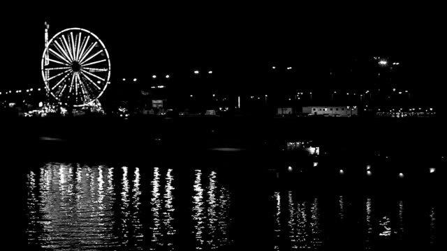 ferris wheel reflection in river at night, black and white - ferris wheel stock videos & royalty-free footage