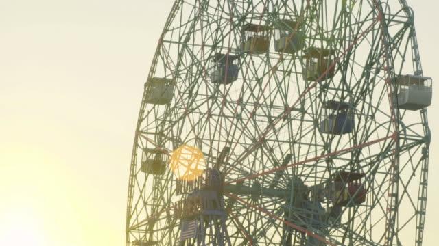 ferris wheel sunset - coney island stock videos and b-roll footage