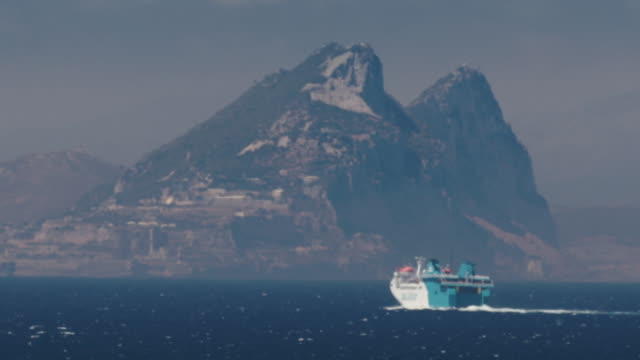ferry and container ships cross the strait of gibraltar - crossing stock videos & royalty-free footage