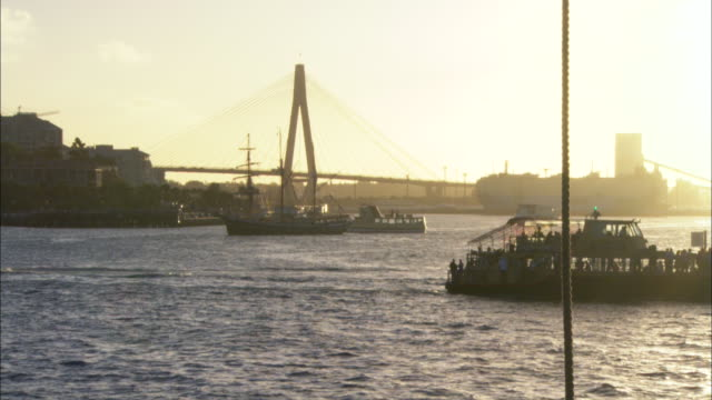 a ferry and other boats cruise across sydney harbor. - ferry stock videos & royalty-free footage