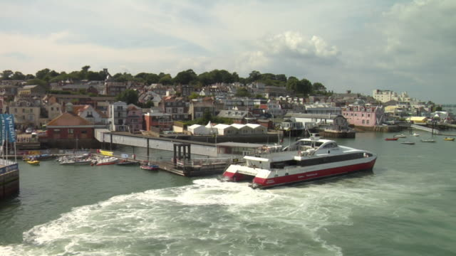 low aerial ferry and townscape / cowes, isle of wight, united kingdom - isle of wight stock videos & royalty-free footage