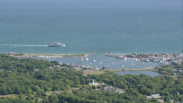 aerial ferry approaching breakwater entrance / oak bluffs, massachusetts, united states - oak stock videos and b-roll footage