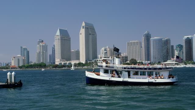 ferry arrives at coronada ferry terminal, san diego - hyatt stock videos & royalty-free footage