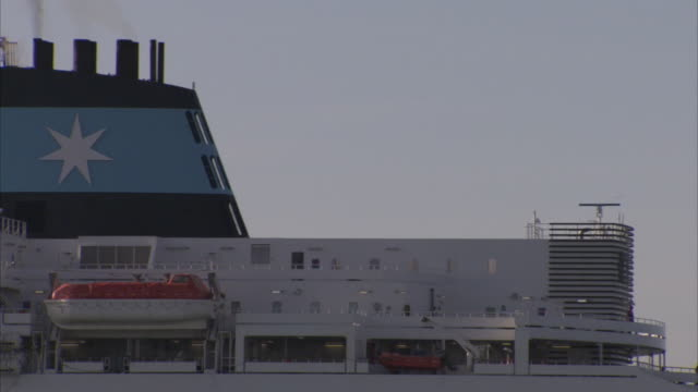 a ferry at the port of dover has red lifeboats and a blue chimney. - dinghy stock videos & royalty-free footage