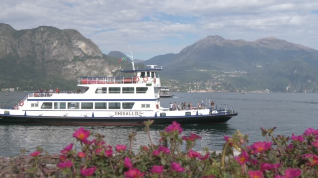 ferry boat arriving lake como lakeside town of bellagio, bellagio, lake como, lombardy, italian lakes, italy, europe - ferry stock videos & royalty-free footage
