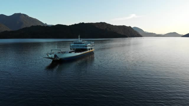 ferry boat arriving to hornopiren in the chilean patagonia - ferry stock videos & royalty-free footage