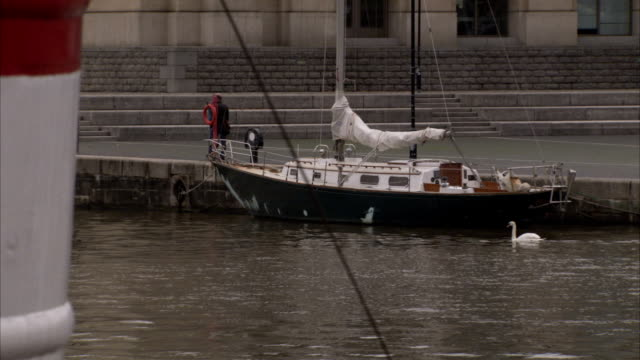 a ferry boat cruises past another docked on the edge of the river avon. available in hd. - ferry stock videos & royalty-free footage