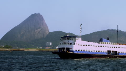 ferry boat passing in front of sugar loaf mountain - 1 minute or greater stock videos & royalty-free footage