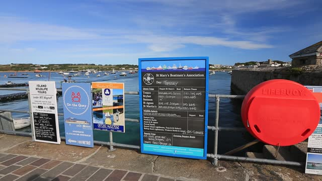 ferry boat timetable in the harbour at hugh town, st mary's scilly isles. - passenger ship stock videos & royalty-free footage