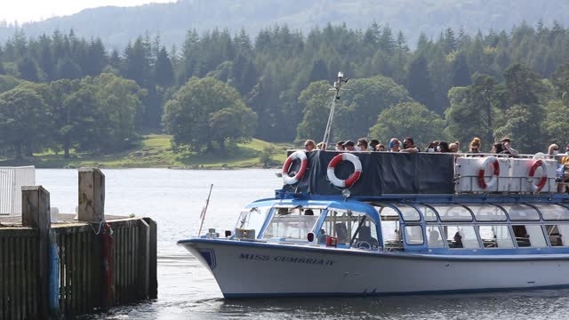 ferry boats at the head of lake windermere with tourists during the corona pandemic, ambleside, lake district, uk. - passenger ship stock videos & royalty-free footage