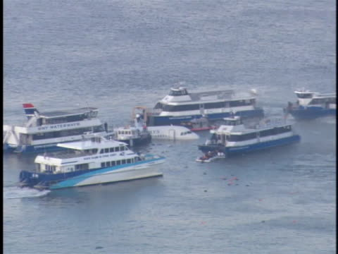 ferry boats gather in the hudson river around the us airways flight 1540 landing site. - river hudson stock videos & royalty-free footage