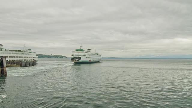 WS POV T/L Ferry boats leaving from Seattle / Seattle, Washington, USA