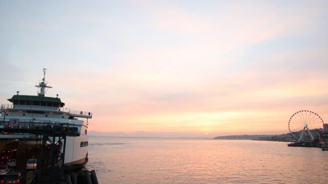 ferry boats leaving the dock on the seattle waterfront at sunset. - passenger ship stock videos & royalty-free footage