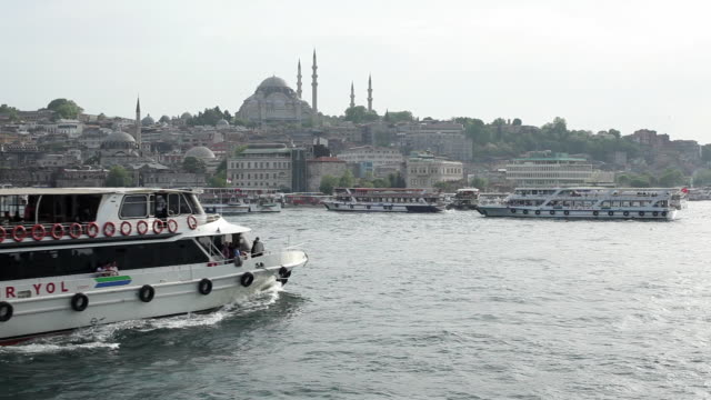 ws ferry boats on golden horn with suleymaniye mosque in background / istanbul, turkey - suleymaniye mosque stock videos and b-roll footage