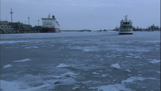 a ferry crosses the icy baltic sea near a port in helsinki, finland. - ferry stock videos and b-roll footage