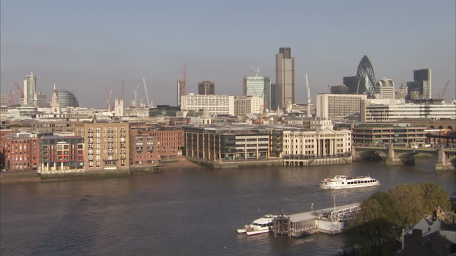 A ferry cruises down the River Thames. Available in HD.