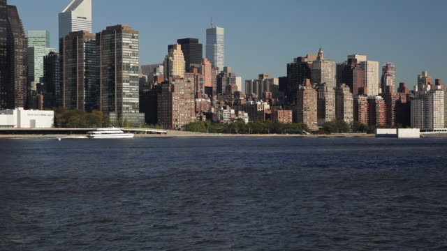 A ferry cruises past Wollman Ice Rink in Central Park on the island of Manhattan.